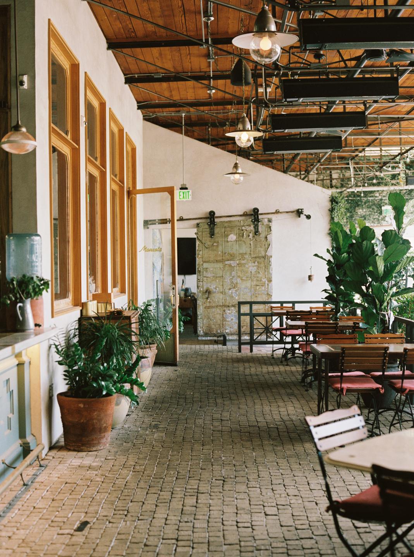 Hauser & Wirth Building Patio Barn Sliding Door Plants Seating Rustic